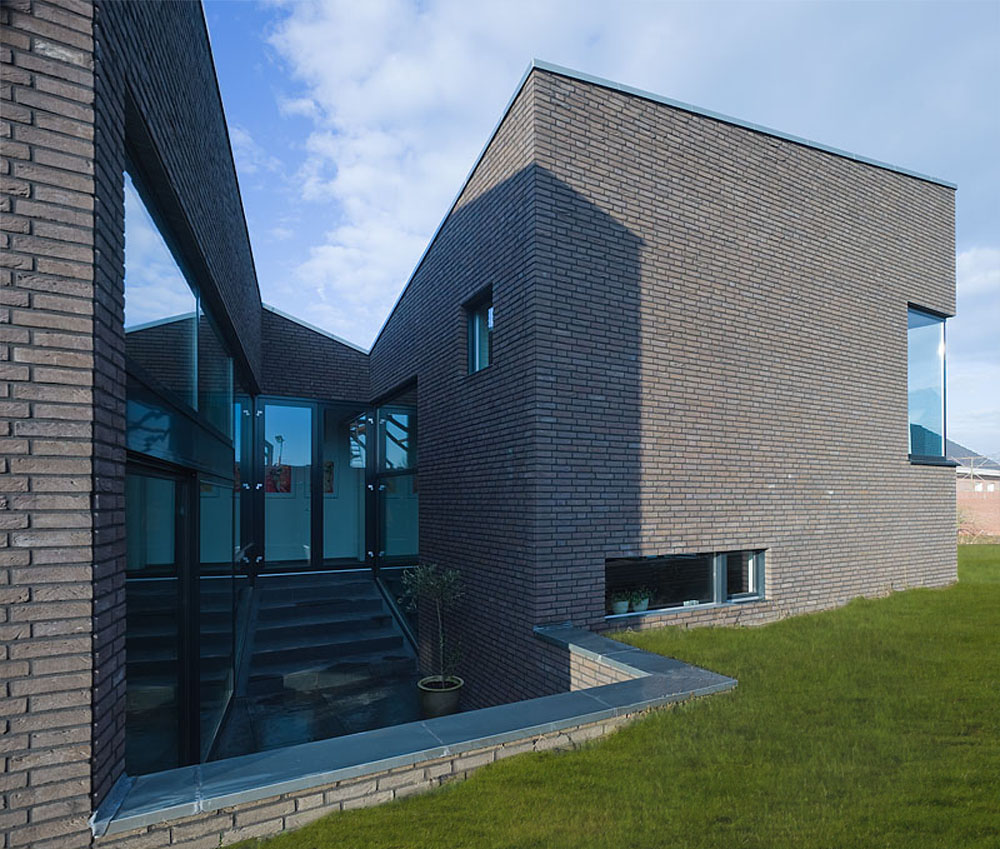 Dwelling-workhouse HDT / Hoogte Twee Architecten
