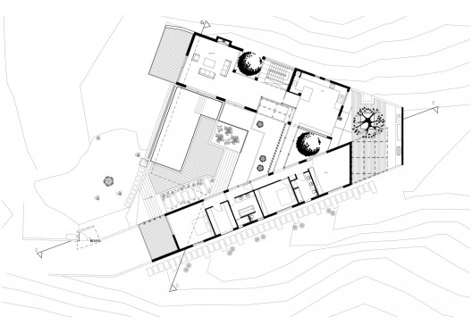 Vassilis residence vardastudio archdaily for X shaped house plans