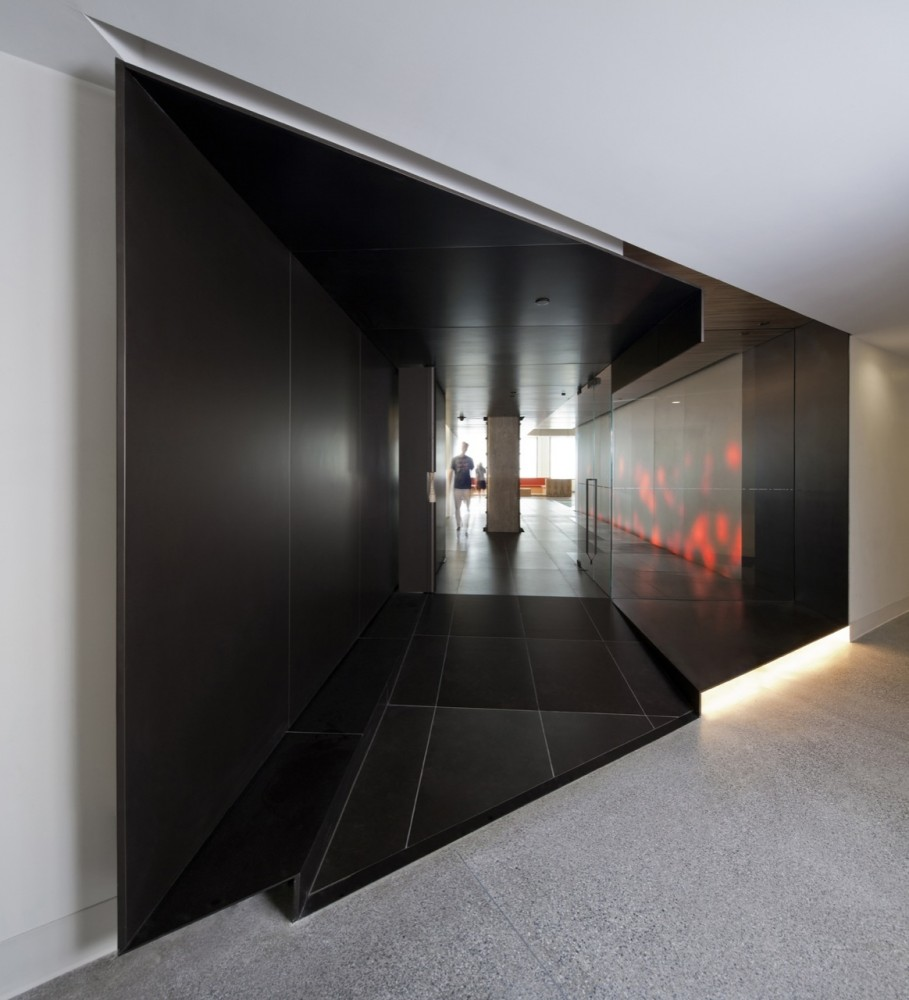 Black And White Image Of Corridor With Glass Walls