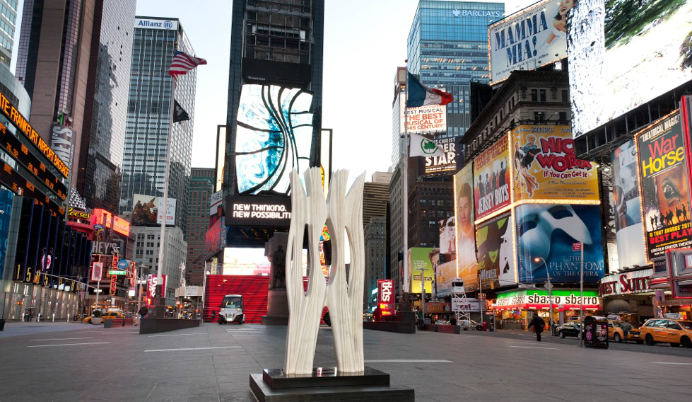 Phantom Oil Pumps and a Soaring Marble Column Arrive in Times Square