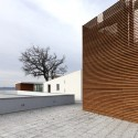 Health Centre and Houses for Elderly People / IPOSTUDIO Architects © Pietro Savorelli