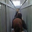 Kalandia Checkpoint. The First New Gate To Jerusalem in 466 Years. (2) Women going though Kalandia © Harris Silver