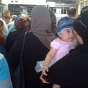 Kalandia Checkpoint. The First New Gate To Jerusalem in 466 Years. (1) Mom and infant passing through Kalandia Checkpoint © Harris Silver