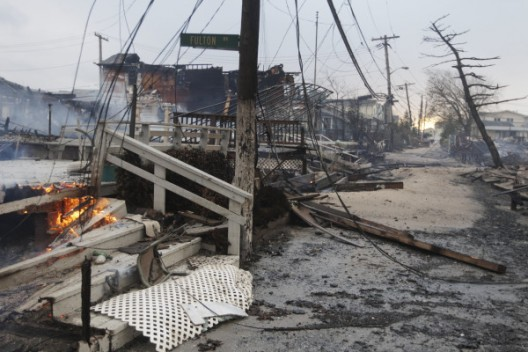 "Twitter User: @c_heller ""Another photo out of Breezy Point. The damage is stupefying. (Frank Franklin II, AP) http://twitpic.com/b8sg51″"