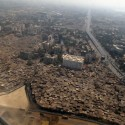 Slum Rehabilitation Promise to Mumbai&#039;s 20 Million Aerial View of Mumbai; Courtesy of Flickr User Cactus Bones; Licensed via Creative Commons
