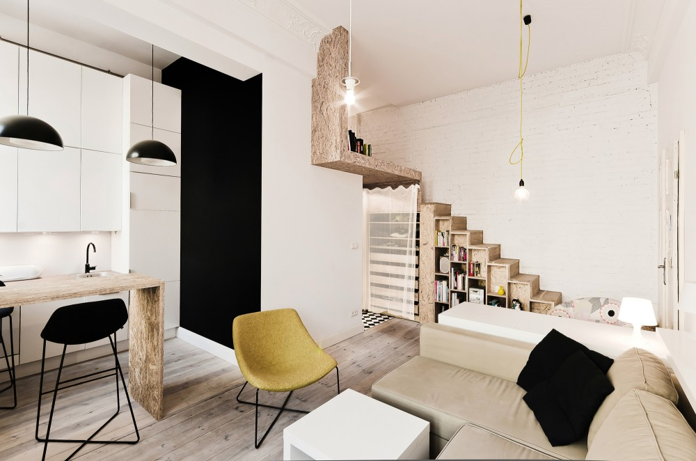 Small apartment incorporates mezzanine bedroom to maximize - How to maximize space in a small bedroom ...