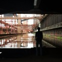 A Photographic Journey Through Zollverein: Post-Industrial Landscape Turned Machine-Age Playground The Reflective Water Tank at the Coking Factory. Image © Gili Merin