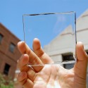Invisible Solar Harvesting Technology Becomes Reality Solar power with a view: MSU doctoral student Yimu Zhao holds up a transparent luminescent solar concentrator module. Image © Yimu Zhao