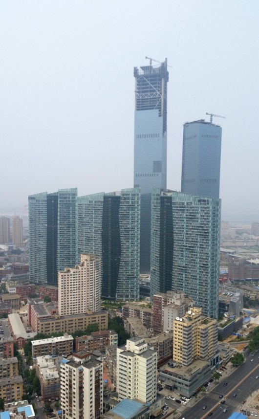 The World's 10 Tallest New Buildings of 2015 54627aeee58eceecb500000d the world s 10 tallest new buildings of 2015 eton place dalian construction1 633x1024 530x857