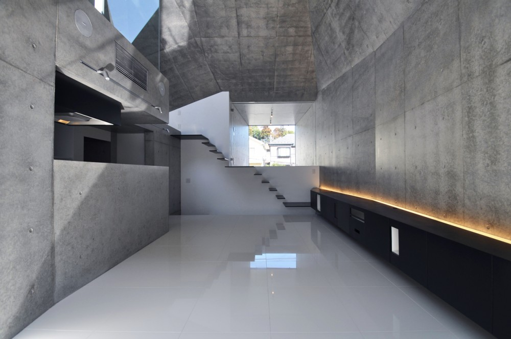 A Monolithic Exposed Concrete Structure House In Abiko