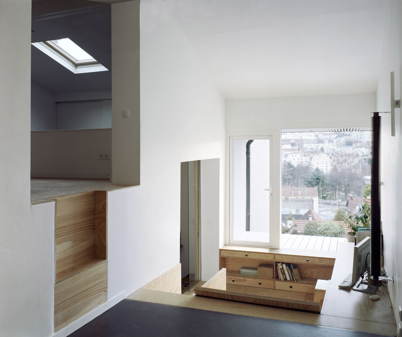 Small House, Suspended Extension by NeM Architectes